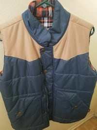 brown and blue vest