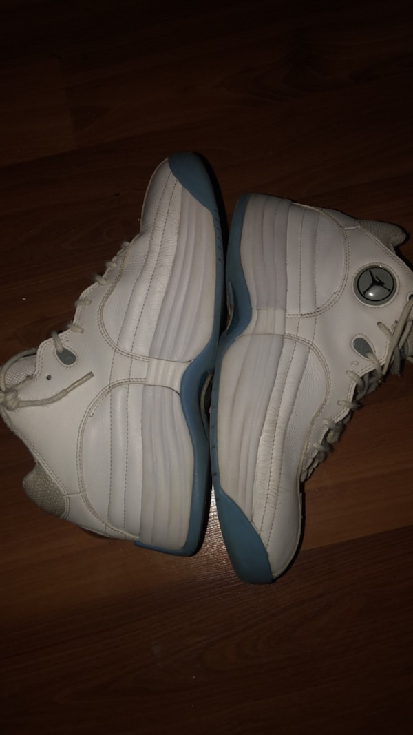 pair of white-and-gray Nike basketball shoes