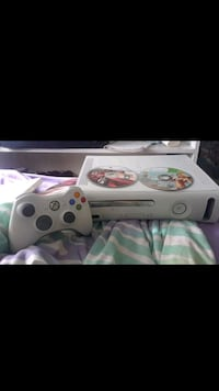 Xbox360 w/remote and cords and two games Fort Lauderdale, 33311