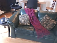 black leather sofa chair with throw pillow Montréal, H4V 2J9