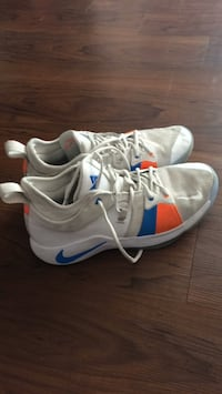 Pair of white-and-blue nike running shoes