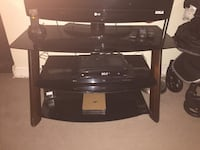 Black smoked glass tv stand holds up to 40 inch tv  Winnipeg, R2W 5G4