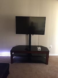 Black and brown TV stand (TV not included)