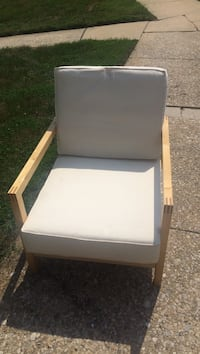 brown wooden framed white cushioned armchair