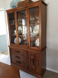 brown wooden framed glass display cabinet Surrey