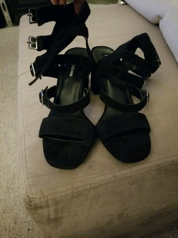 Black strappy shoes 60bed911-45bc-4582-8272-255e46a861c9
