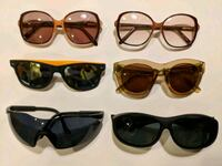 four black framed sunglasses with brown lens