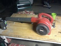 red and black leaf blower