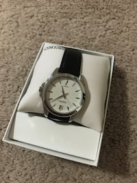 round silver analog watch with black leather strap Airdrie, T4B 3R9
