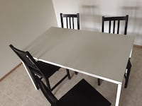 Barley Used Dinning Table + for Chairs for Sale!!  Calgary, T2Y 3G3