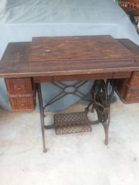 brown wooden sewing machine table