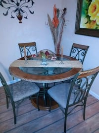round brown wooden table with four chairs dining set Kenneth City, 33709