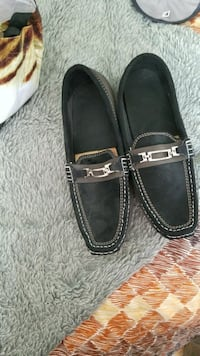 pair of black leather loafers Montreal, H3R 3L4