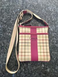 Women's pink and beige Coach sling bag