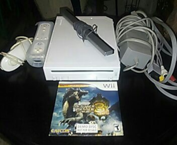 white Nintendo Wii console with controller and gam