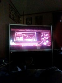 gray and black rear projection TV