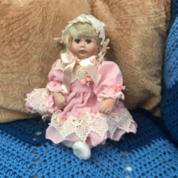 White and pink dressed doll