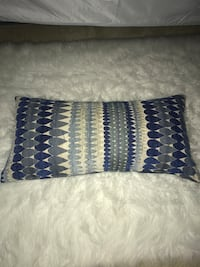 Blue patterned pillow about 2 ft in length. Perfect for center of the bed or couch Reston, 20194