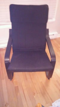 black wooden framed black leather padded armchair Laval, H7H 2Z5