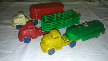 Antique banner toy trucks and cars 1950