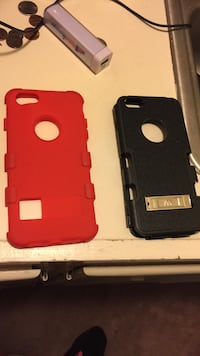 two black and red iPhone cases