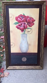 brown wooden framed painting of red flowers