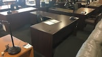brown wooden desk with black leather rolling armchair Rockville, 20852