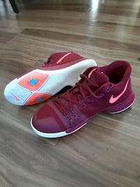 pair of pink-and-white Nike running shoes Winnipeg, R3T