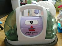 white and purple Bissell Little Green vacuum cleaner
