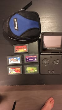 GameBoy Advance SP with 5 games Delta, V4C 1P7