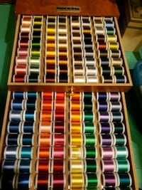 80 spools of embroidery Thread plus chest.