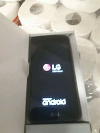 black LG 4 android smartphone with box Calgary, T2A 6T7