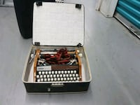 black and gray typewriter with case Toronto, M9W 4G4