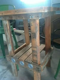 brown wooden table with chairs 498 mi