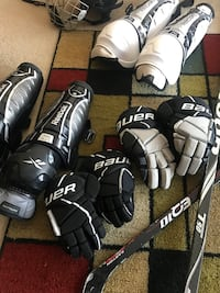 two pairs of black-and-white Reebok knee guard and two pairs of black-and-white Bauer gloves Alexandria, 22304