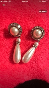 Two silver and diamond pearl earrings