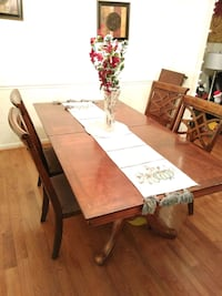 Solid wood fine table and chairs. 20 mi