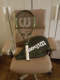 white and black Wilson tennis racket with bag