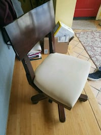 brown wooden framed white padded rolling armchair Pacific Grove, 93950