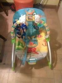 baby's yellow, white, and blue bouncer