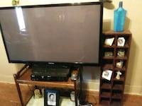 black flat screen TV with brown wooden TV stand Virginia Beach, 23451