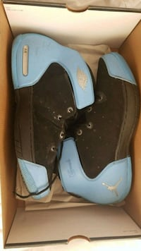 pair of black-and-blue Air Jordan shoes