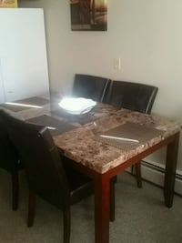 rectangular brown wooden table with six chairs din Calgary, T3B