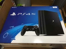 Sony PS4 Pro console with controller box