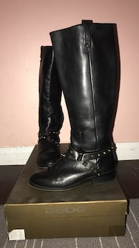 pair of women's black Bebe leather knee-high boots with box