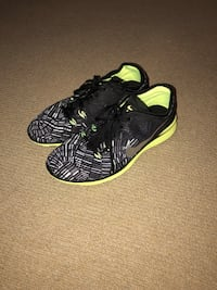 Pair of black-and-green nike running shoes Atlanta, 30305