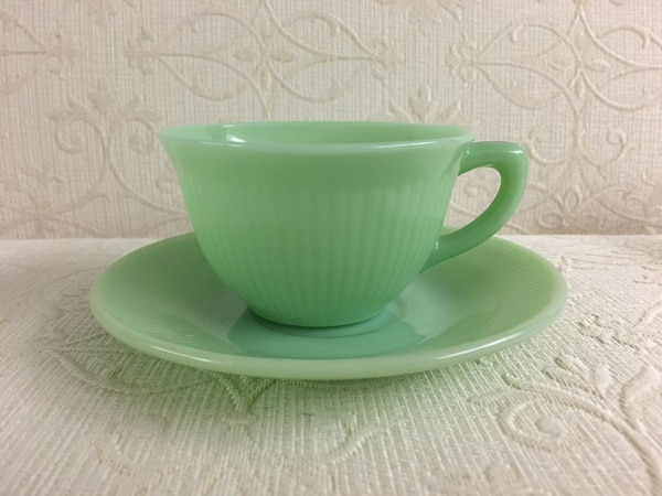 Cup and saucer depression glass