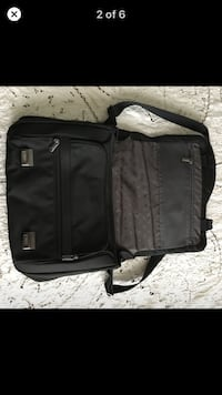 TUMI flip flap laptop bag