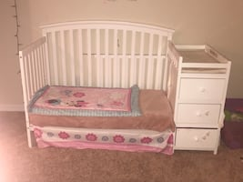 Crib with attached changing table