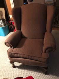 Brown fabric wing chair